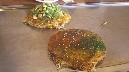 Okonomiyaki, aka eggy pancakes with noodles and stuff in the middle. It actually had a barbecue taste to it.